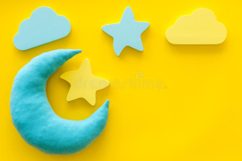 Night sleep concept with moon, stars, cloud toy on yellow background top view mockup. Good dream. Night sleep concept with moon, stars, cloud toy on yellow royalty free stock photography