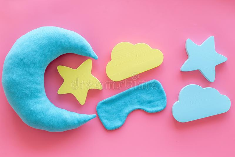 Night sleep concept with moon, stars, clouds toy and mask on pink background top view. Good dream. Night sleep concept with moon, stars, clouds toy and mask on royalty free stock images