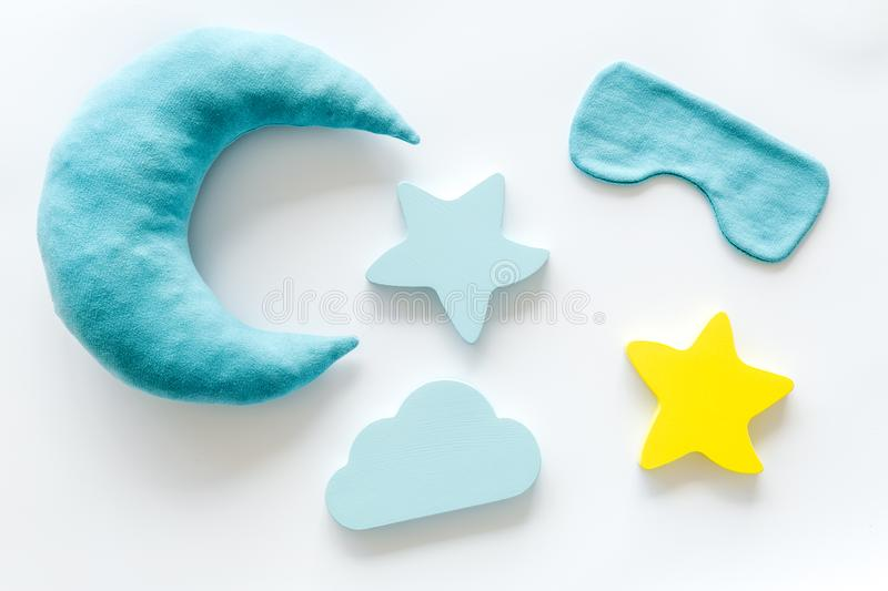 Night sleep concept with moon, stars, clouds toy and mask on white background top view. Good dream. Night sleep concept with moon, stars, clouds toy and mask on royalty free stock image