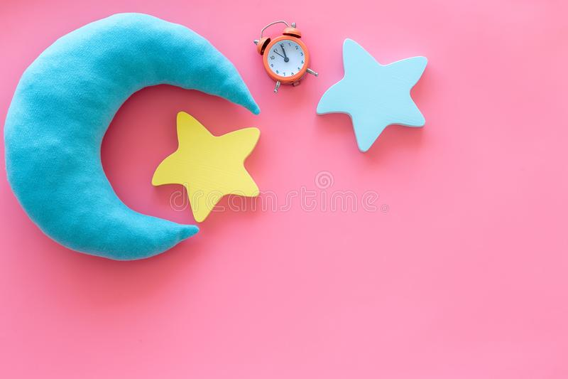 Night sleep concept with moon, stars toy and alarm clock on pink background top view mockup. Good dream. Night sleep concept with moon, stars toy and alarm clock royalty free stock image