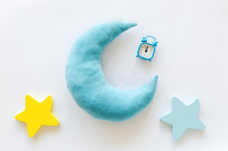 Night sleep concept with moon, stars toy and alarm clock on white background top view. Good dream. Night sleep concept with moon, stars toy and alarm clock on royalty free stock image