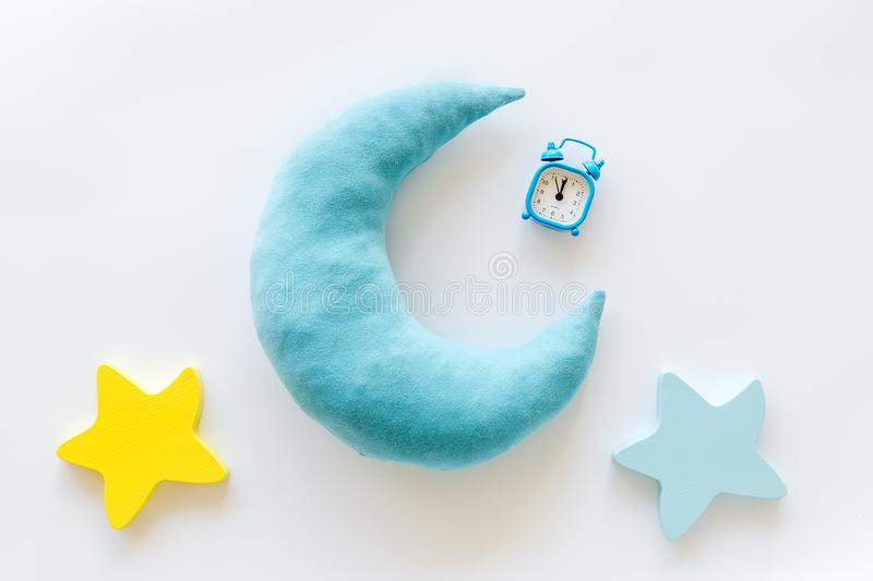 Night sleep concept with moon, stars toy and alarm clock on white background top view. Good dream. Night sleep concept with moon, stars toy and alarm clock on stock photography