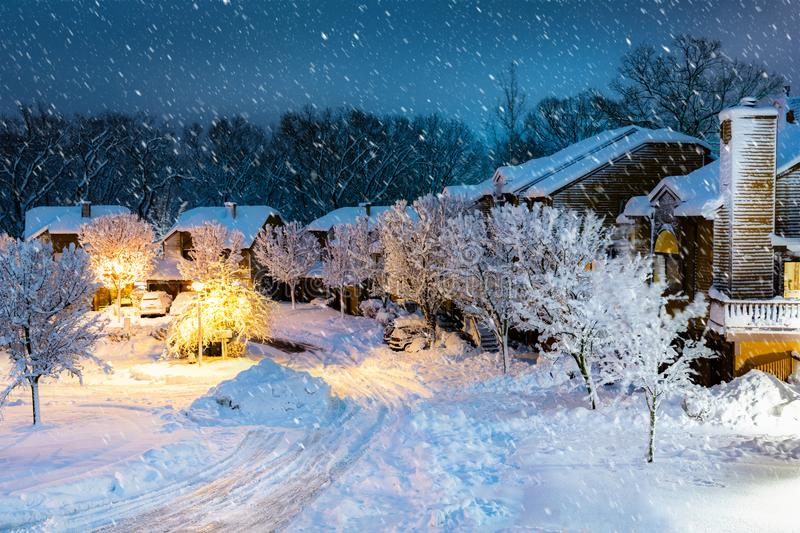 Night snowfall in a New Jersey village. With wooden houses royalty free stock photo