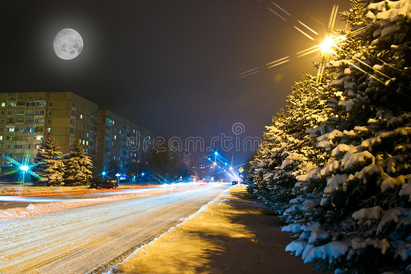 Night Snowy Road In The Small Town Royalty Free Stock Photos