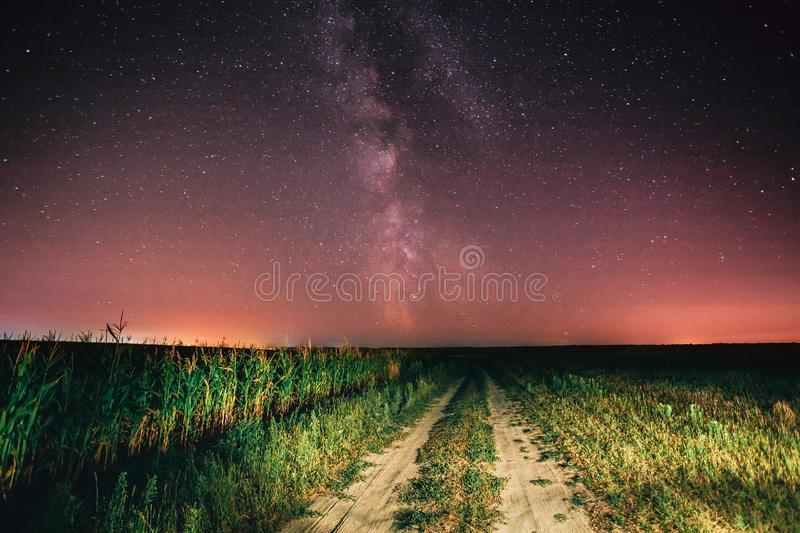 Night Starry Sky With Milky Way Glowing Stars And Country Road I. N Countryside In Summer Field Landscape stock image