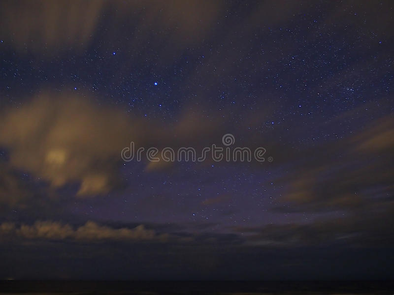 Night sky stars and clouds royalty free stock photography