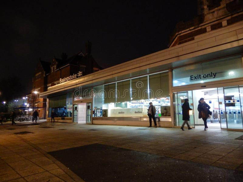 Night station. Basingstoke, United Kingdom - January 11 2018: The front entrance to Basingstoke Railway Station at nght royalty free stock photography