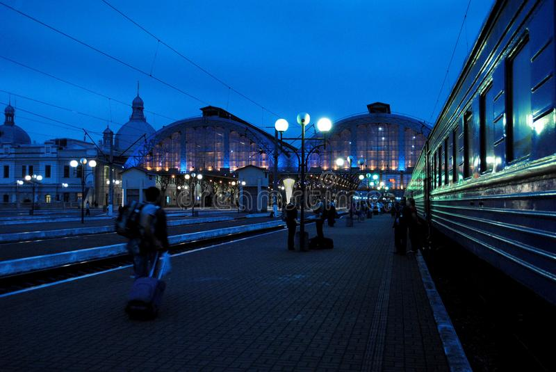 At the station people hurry home. At night on the station perron, people rush home and on their own business stock image