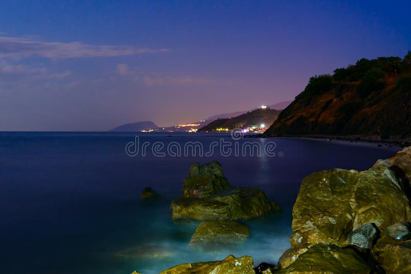 The night stones are washed by the surf. Long exposure royalty free stock photography