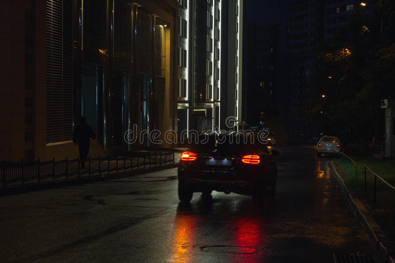 Night street and cars. In the rain royalty free stock photos
