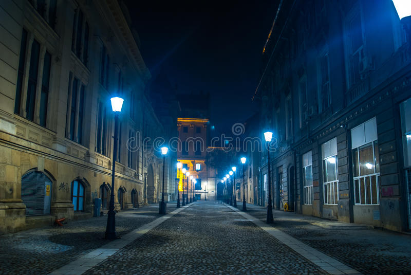 Night Street. Fantastic night scene of an empty street with street lamps in the historical Center of Bucharest royalty free stock photo