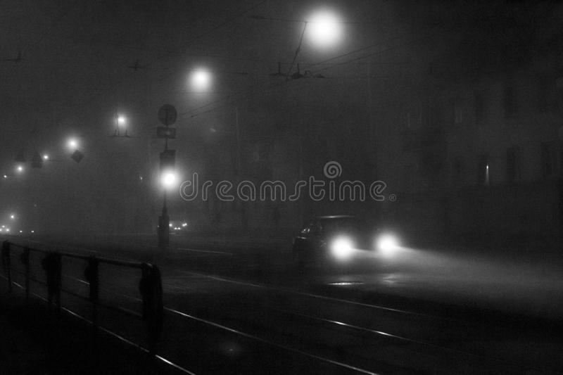 Night street in the fog. Car. Minsk royalty free stock photos