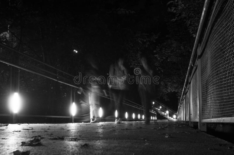 Night street life in the city. Motion blur royalty free stock photo