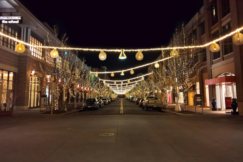 Night time, empty retail street with lights stock photo