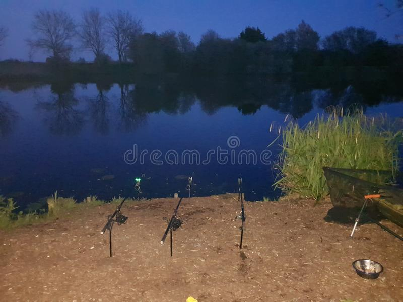 Night time fishing stock photography