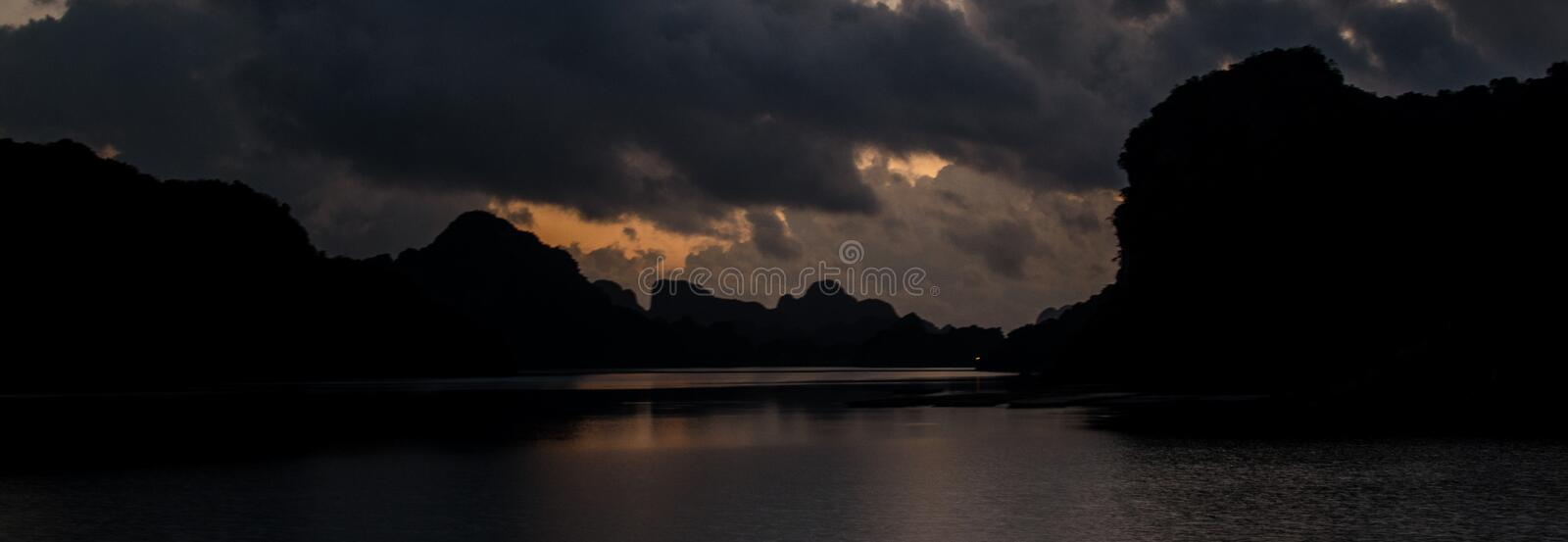 Night time in Ha Long Bay. Whilst party boat cruises by stock images