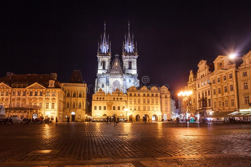 Night time illuminations of the magical Old Town Square in Prague, visible are Kinsky Palace and gothic towers of the Church stock photo