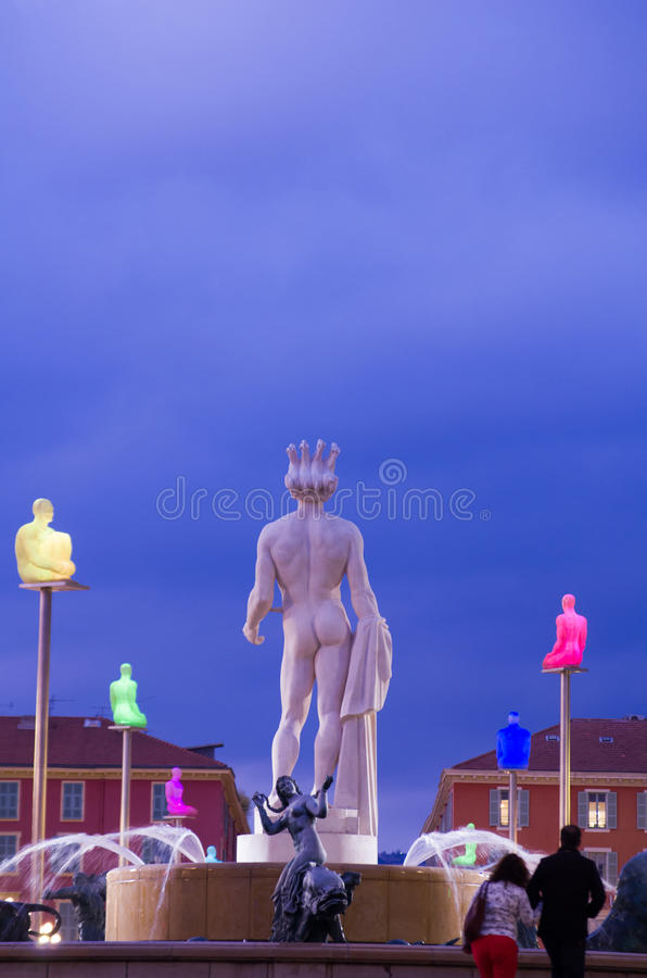 Night time image of La Fontaine du Soleil. (The Fountain of the Sun) with the Statue of Apollo in Nice, Cote d'Azur, France stock photo