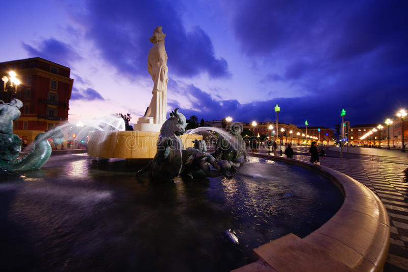 Night time image of La Fontaine du Soleil. (The Fountain of the Sun) with the Statue of Apollo in Nice, Cote d'Azur, France royalty free stock photography