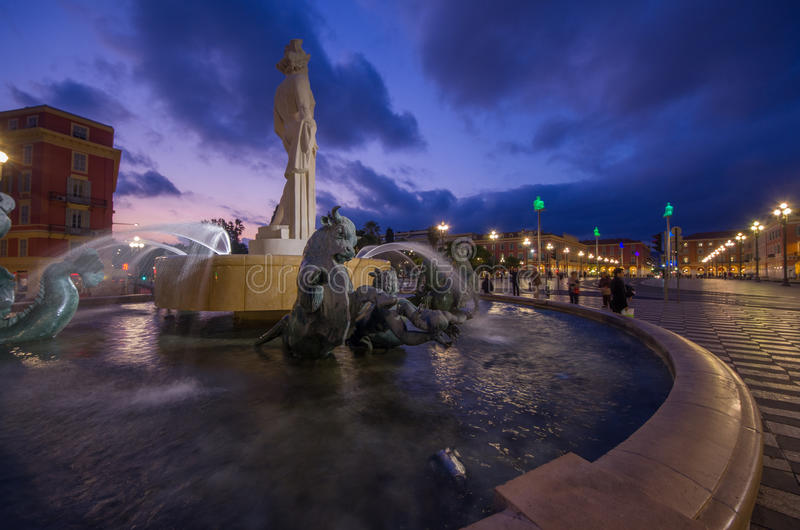Night time image of La Fontaine du Soleil. (The Fountain of the Sun) with the Statue of Apollo in Nice, Cote d'Azur, France stock images