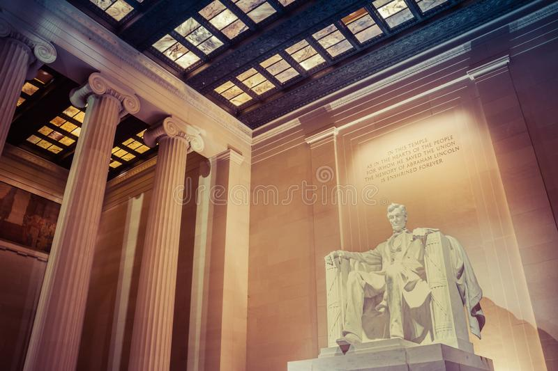 Night time image of the statue of Abraham Lincoln. In the Lincoln Memorial in Washington DC royalty free stock image