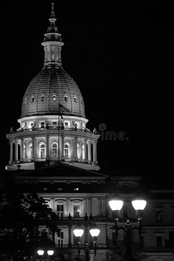 Lansing State Capitol Building in Michigan at night in black and white. Night time with the Michigan State Capital in Lansing. Keeping it black and white due to royalty free stock photo