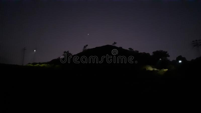 Night time mountains and stars and trees stock images