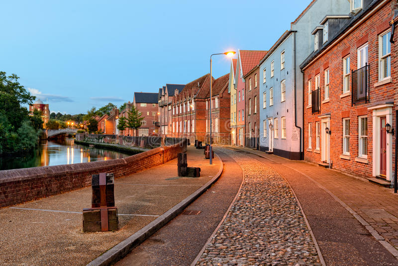 Night time in Norwich. Town houses overlooking the river Yare in Norwich, Norfolk royalty free stock photo