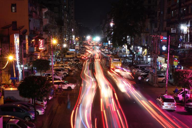 Night time and speed of light at Anawrahta Rd. with the car people and building stock images