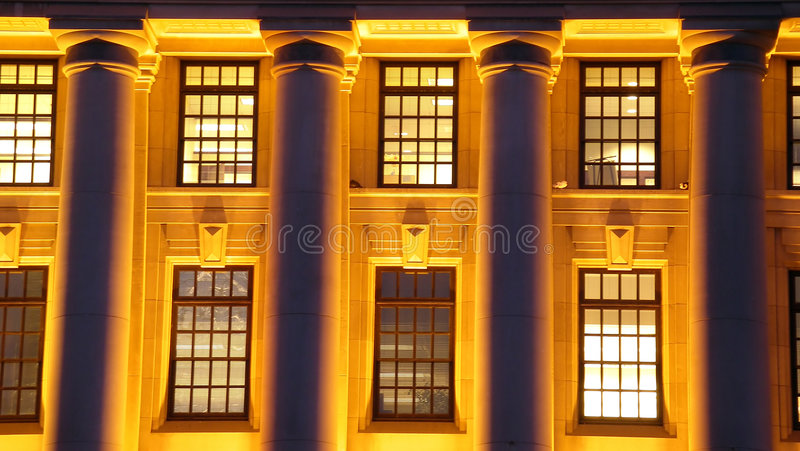 Night time structure. Long exposure of columns on a building at night time. Symetry and pattern royalty free stock photography