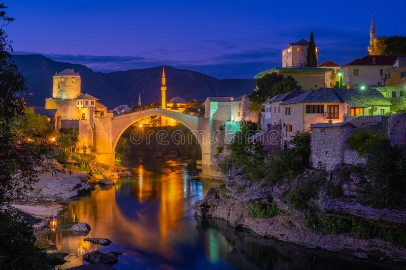 Stari Most, Mostar. Night time view of the city of Mostar lit up along the river, featuring the rebuilt arched bridge: `Stari Most royalty free stock photography