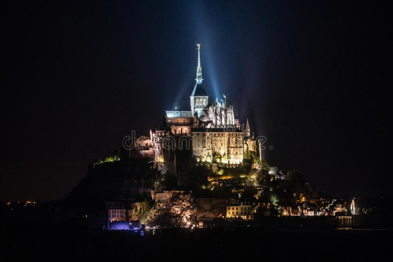 Night time view of Mont saint Michel in Normandy France stock image
