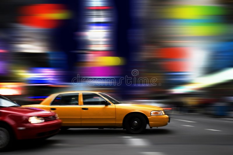 Night in Times Square. Cab rushing through colorful New York's Times Square at night stock image