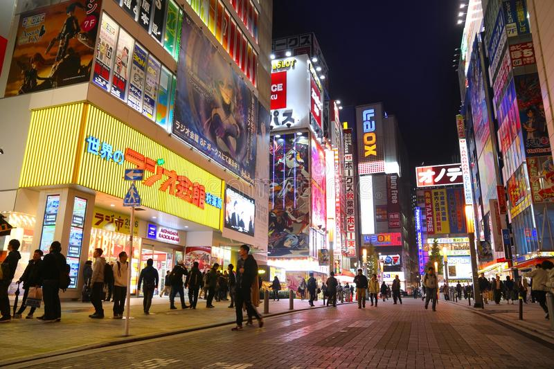Night Tokyo, Japan. TOKYO, JAPAN - DECEMBER 1, 2016: People visit Akihabara district of Tokyo, Japan. Akihabara is also known as Electric Town district, it has stock images