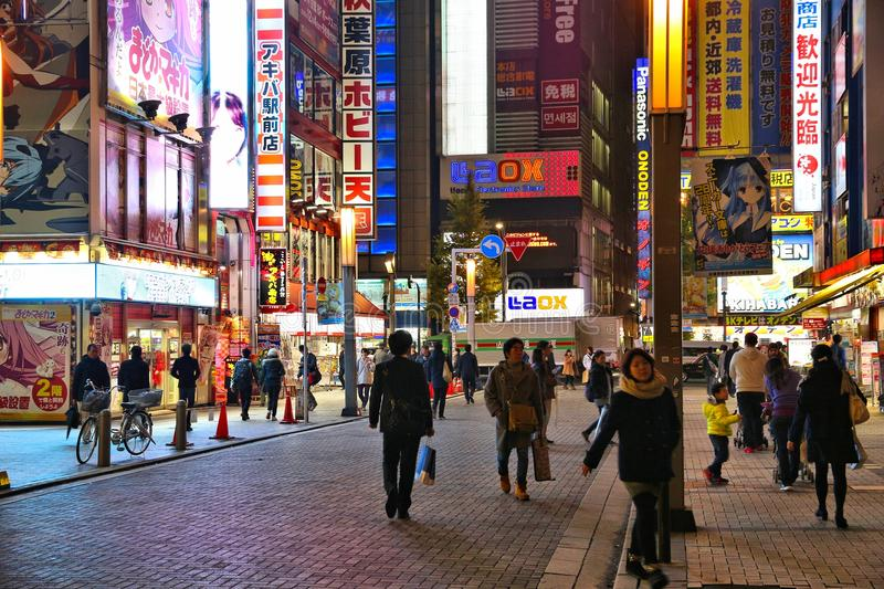 Night in Tokyo. TOKYO, JAPAN - DECEMBER 1, 2016: People visit Akihabara district of Tokyo, Japan. Akihabara is also known as Electric Town district, it has stock image