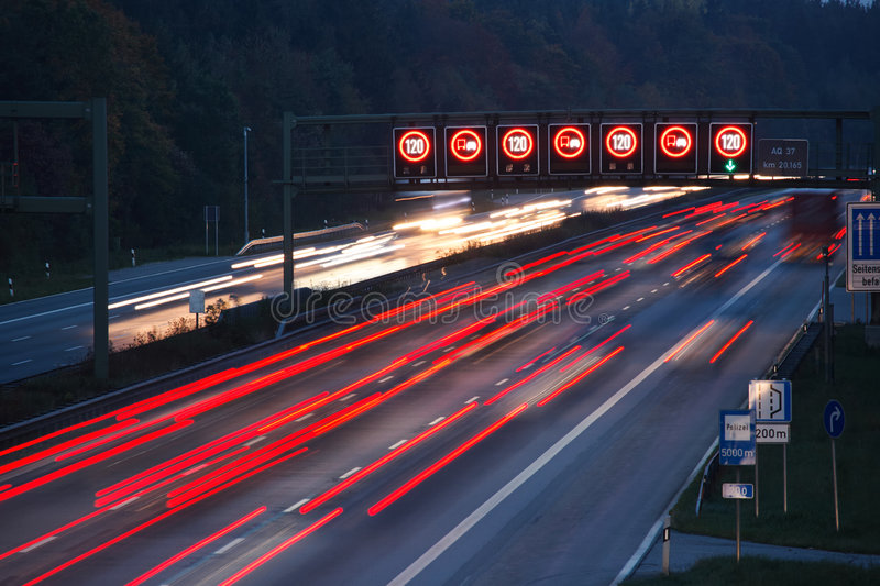 Night traffic. With speed limit sign on German autobahn royalty free stock image