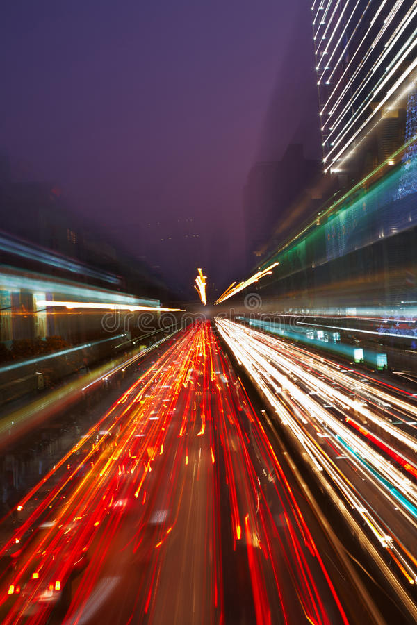 Night traffic in the city. Car lights in motion blur with zoom effect