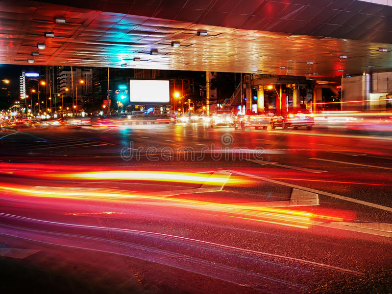 Night traffic in the city background with light trails and billboard blank for outdoor advertising poster or blank. Billboard at night time for advertisement royalty free stock photo