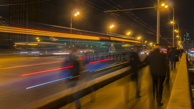 Night traffic and the crowd of people on urban street, royalty free stock photos