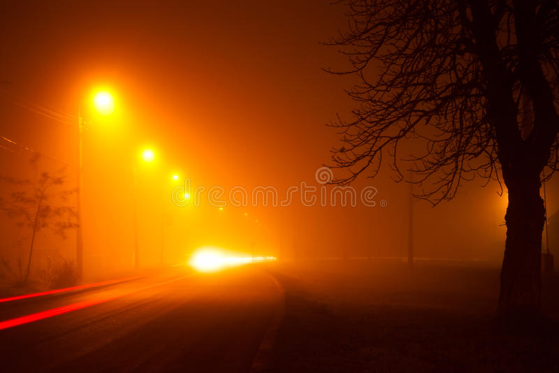 Night traffic in fog stock photography