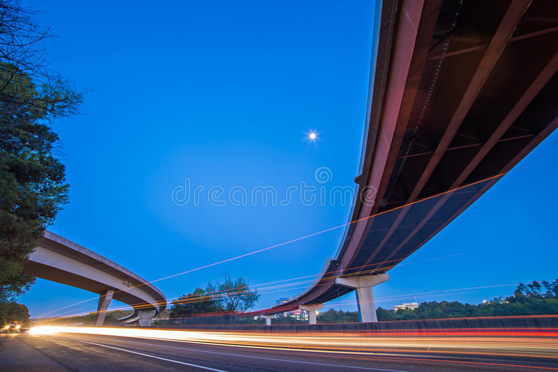 Night traffic with light trails on highway interchange royalty free stock photos