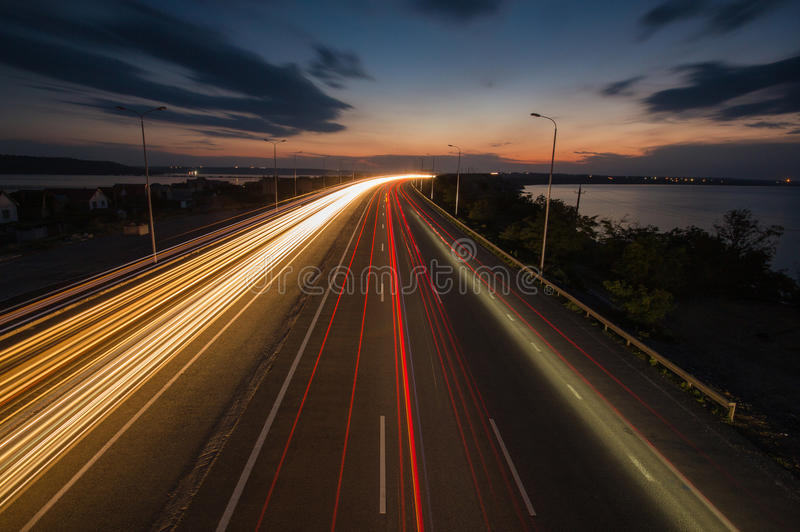 Night traffic lights on the highway royalty free stock photos