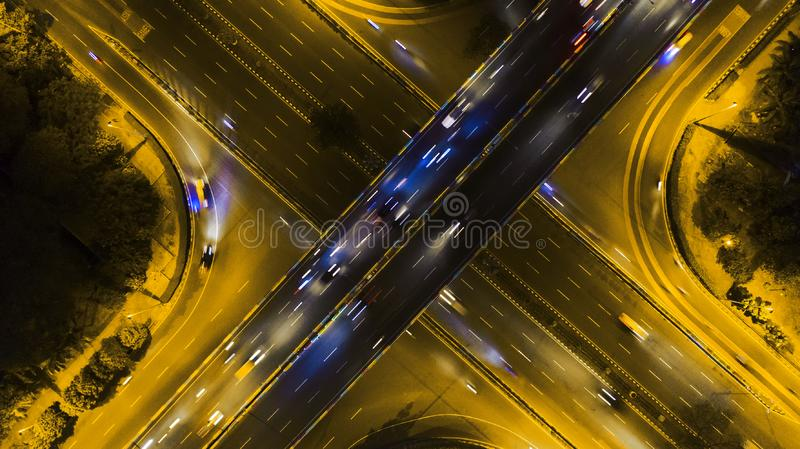 Night traffic on overpass tollway. JAKARTA - Indonesia. October 22, 2018: Aerial view of night traffic on overpass tollway and road interchange royalty free stock photo