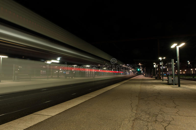 Night Train. Passing thorugh Danish station odense stock image