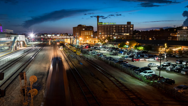 Night train travels through the crossroads district of Kansas City Missouri. A cargo train passes bars and restaurants in the crossroads district in the stock photo