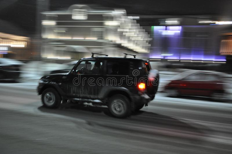 Night Tula. A blurry photo. Car movement. The photographer`s vision. Night traffic. Black car in motion on the night street of the city. speed royalty free stock photo