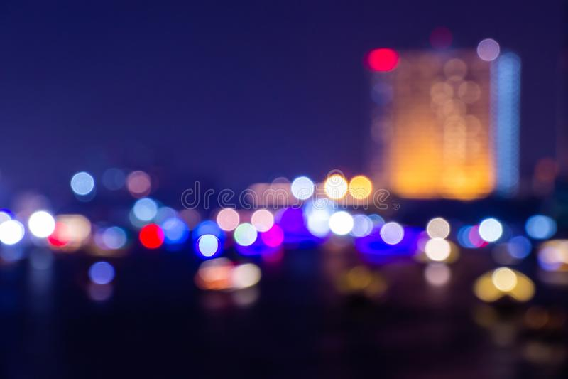 Night twilight blurred light bokeh in downtown bangkok abstract background stock images