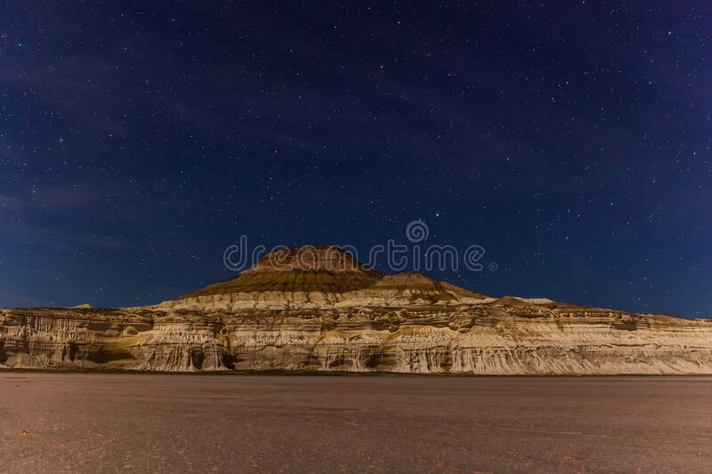 Night. The Ustyurt Plateau. District of Boszhir. The bottom of a dry ocean Tethys. Rocky remnants. Kazakhstan. long shutter speed. Night. The Ustyurt Plateau royalty free stock images
