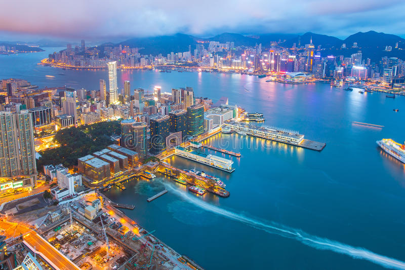 Night at the Victoria Harbor in Hong Kong city skyline stock photography