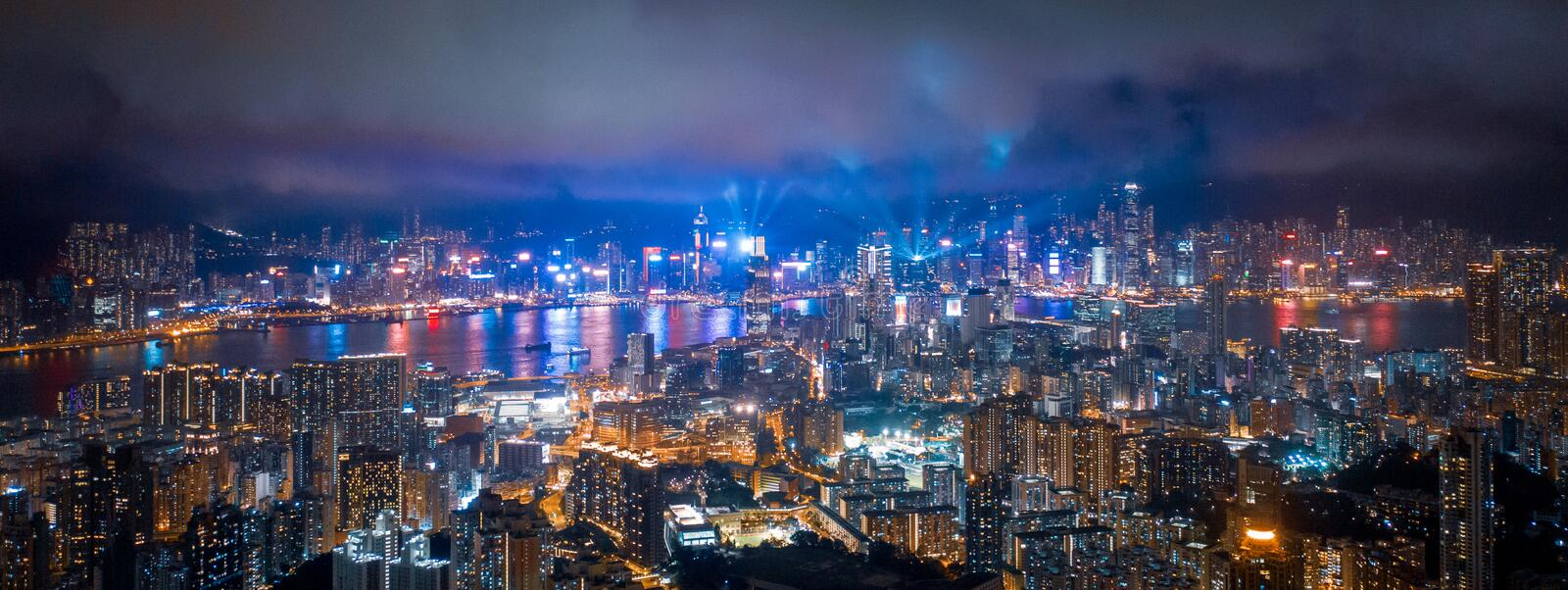 Night of victoria harbor, Hong Kong. Sparking light around the city stock photos